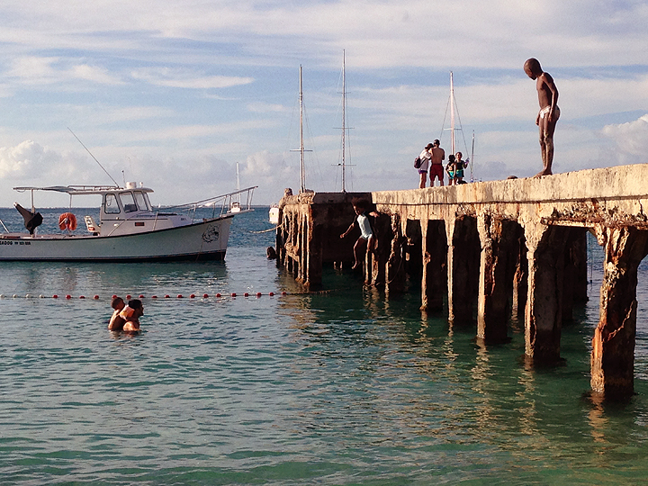 Local kids jumping off the commercial pier