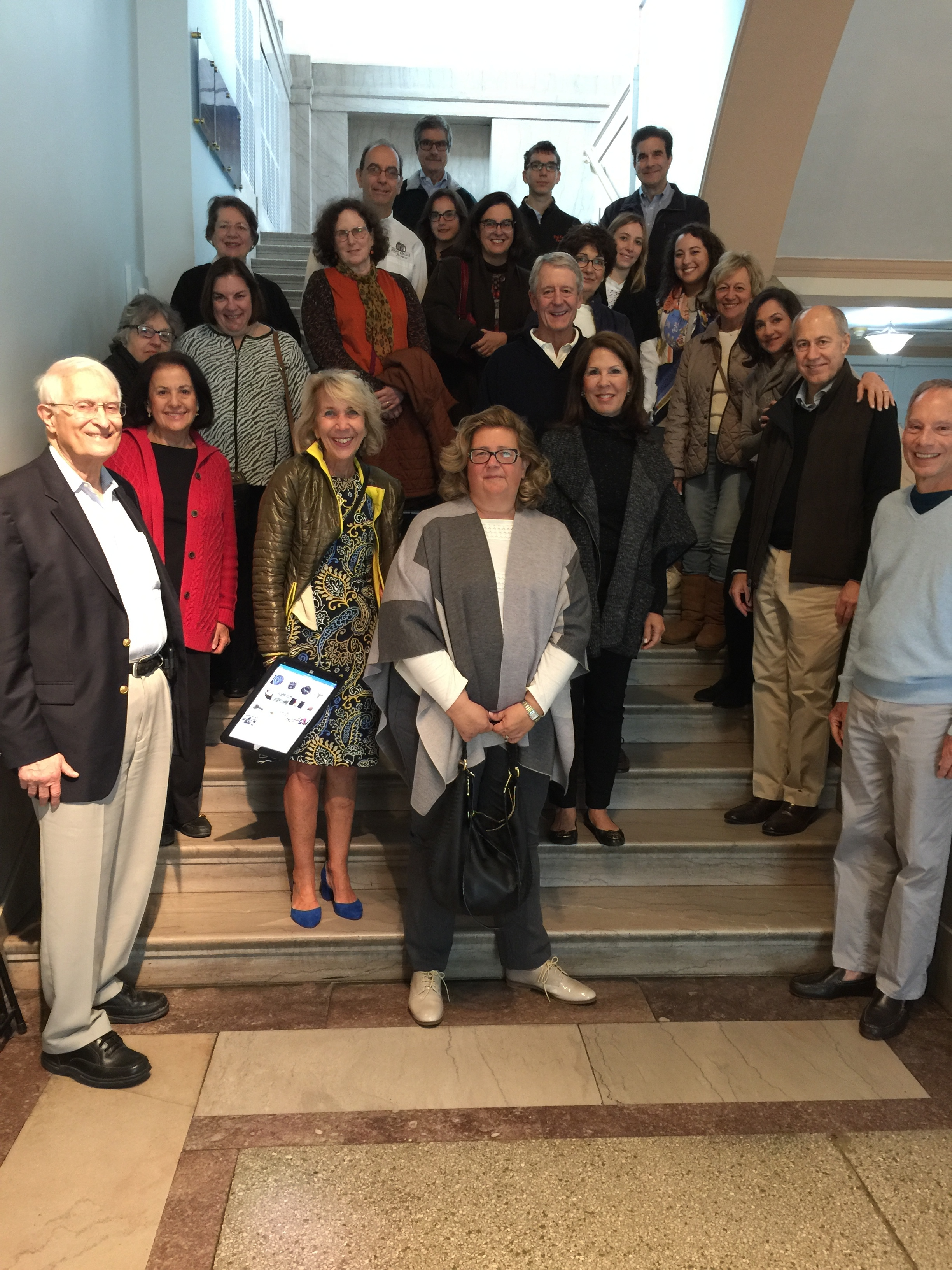 """HUC members enjoying a tour of the Penn Museum of Archaeology and Anthropology, guided by HUC member and classical archaeologist Anna Hadgis (bottom left in the blue shoes!). The theme of the tour was """"Journey to the City: From Mesopotamia to Philadelphia"""" and explored the brand new Middle Eastern galleries in the museum."""