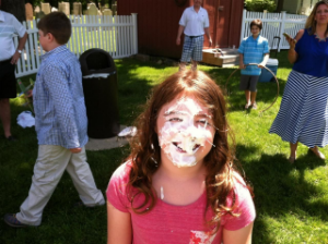 One of our kids enjoying the pie throw at our church picnic.