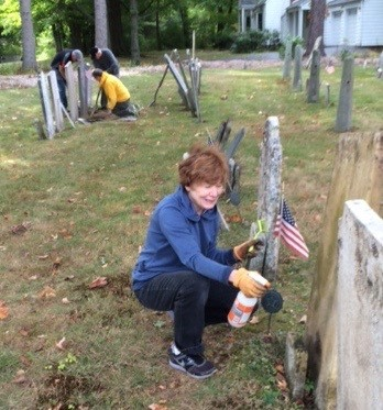 Helping to restore the surface of one of our colonial-era gravestones.