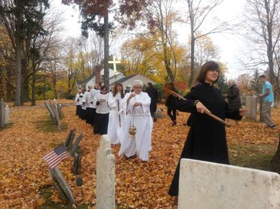 Liturgical Assistants leading our procession from the graveyard on All Saints' Sunday