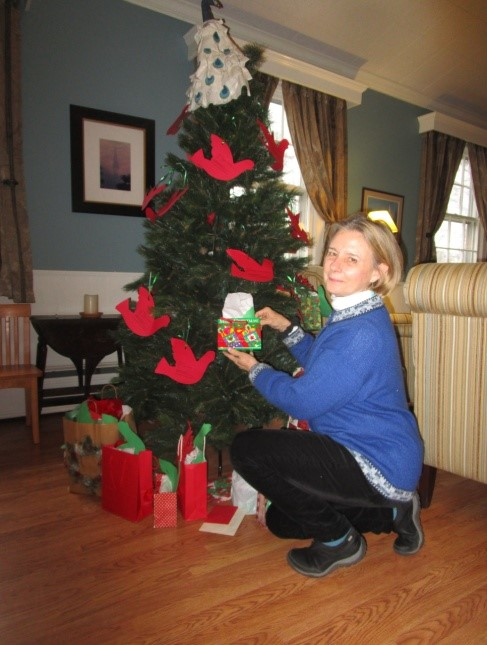 Leslie Frieberg decorating our Dove Tree