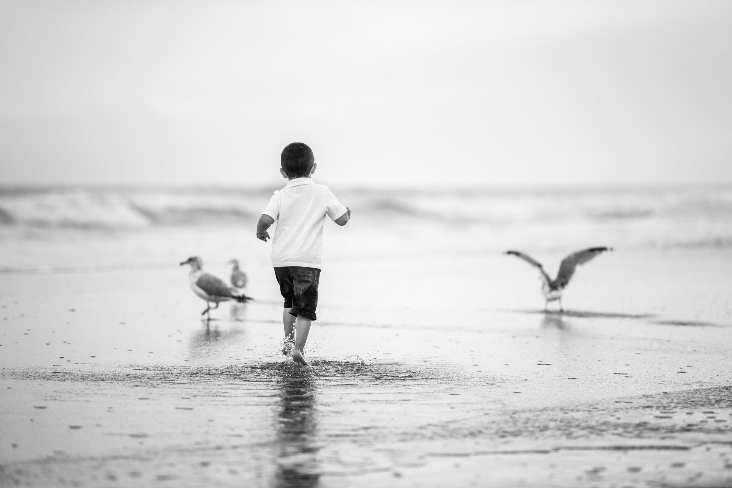 "Little James was having a blast running through the ocean, aka ""river""."