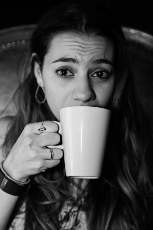 """""""Pic my friend and fellow comic, Maria Shehata took of me in a weird coffee shop in London. I have really big expressive eyes. My sister calls them 'Frozen eyes' cause they are cartoon big and I can't hide my emotions and its kinda what I like about this pic."""" / PHoto Courtesy Liz miele"""