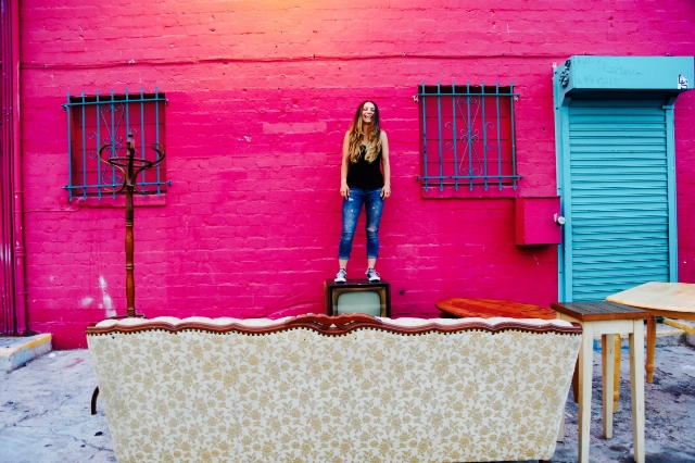 """""""Maria Shehata took this of me in LA in Echo Park. These people were moving to Portland and couldn't bring their furniture so they were dumping it behind this bookstore but decided to set it up like a living room."""" / Photo Courtesy Liz Miele"""