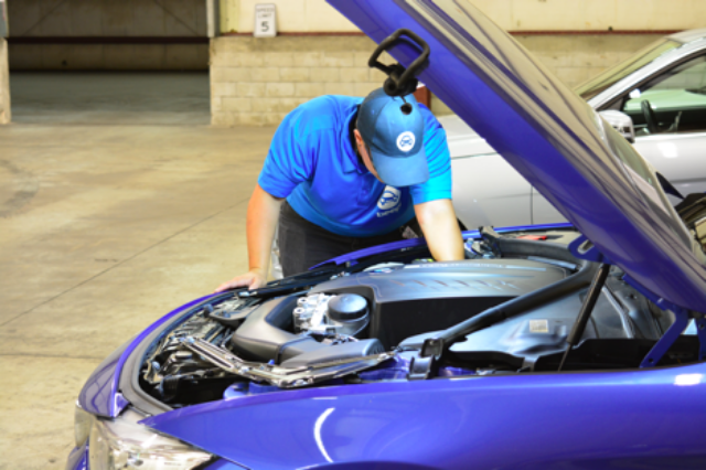 Jocelyn performing a comprehensive 240-point inspection, which certifies Beepi Cars / Photo Courtesy Beepi.