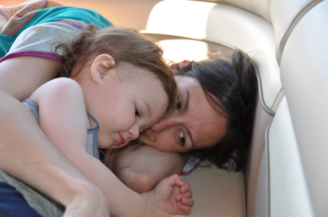 Sarah and Scarlett snuggle on a family vacation shortly after her symptoms began / Photo Courtesy Frank Kay