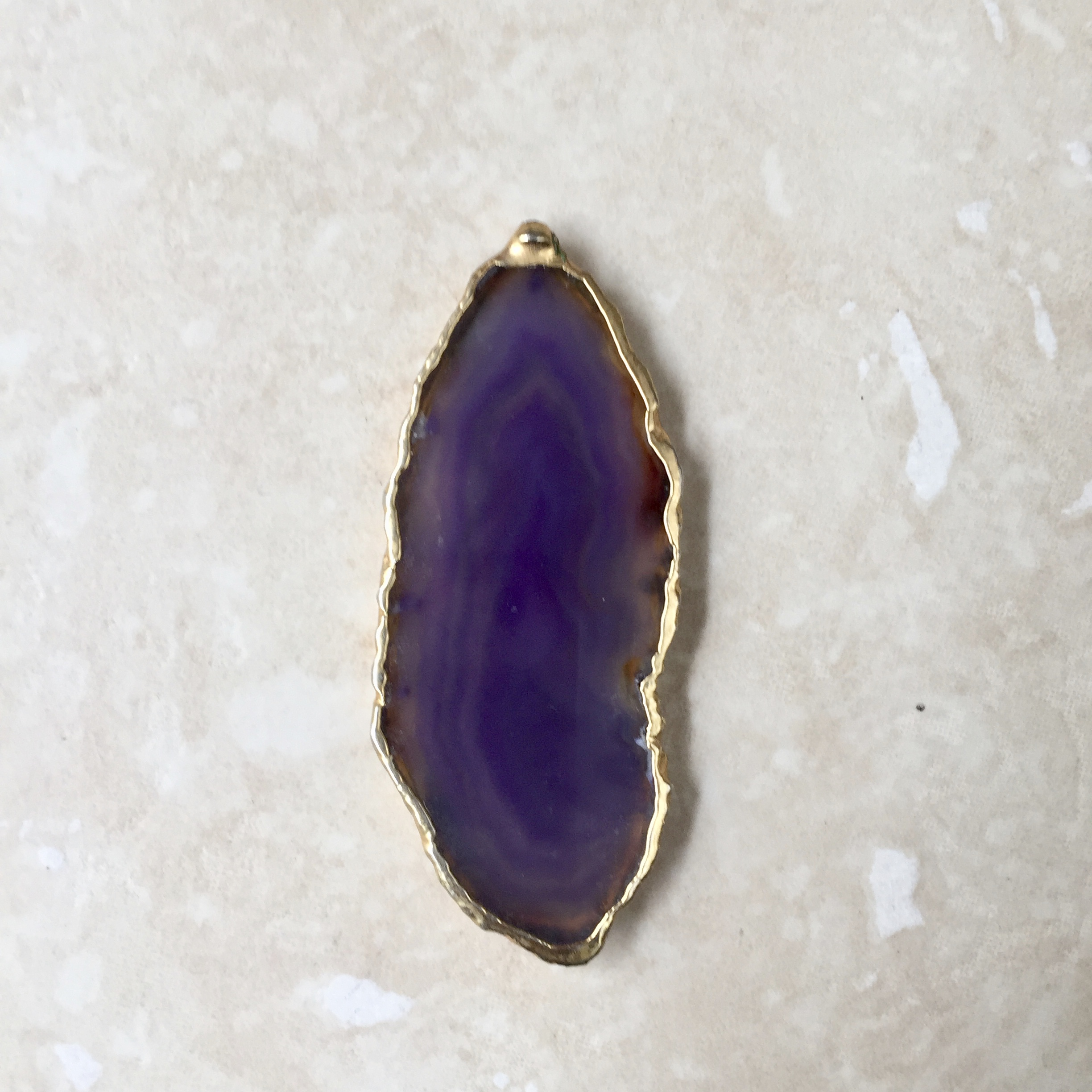 Dyed agate with edges painted in gold