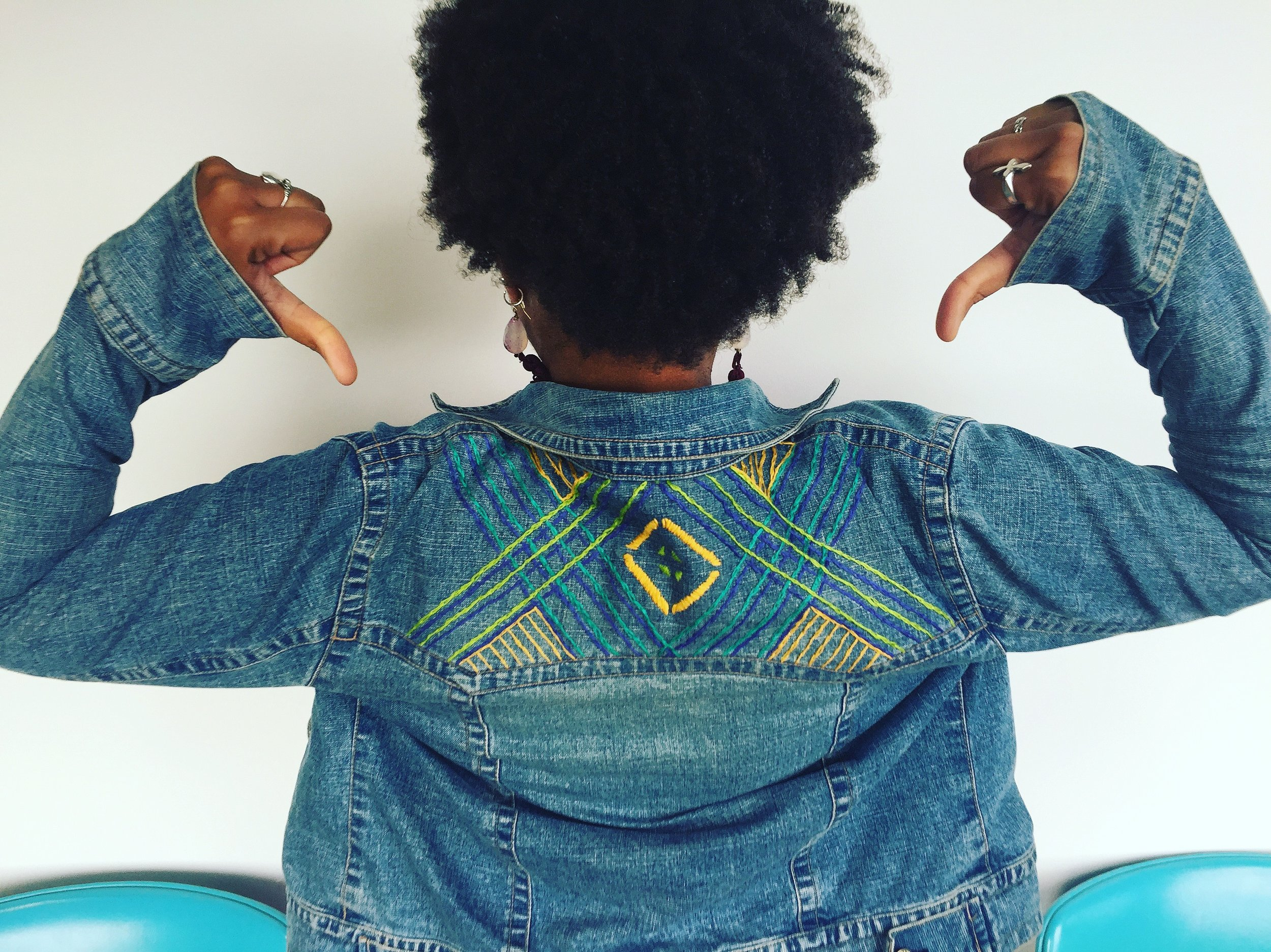 The denim jacket that I hand embroidered with a geometric design is one of my favorite pieces of 2017. And the earrings are my creation too.