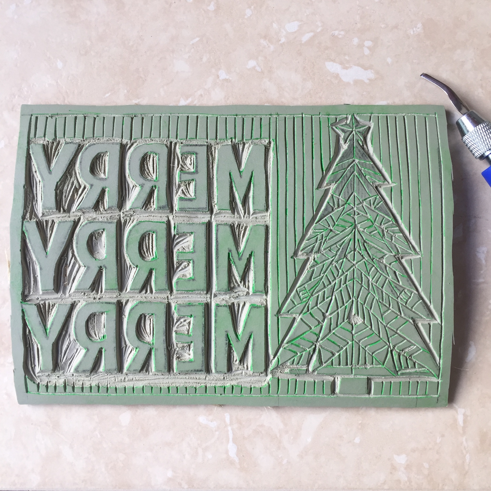 The hand carved linoleum plate.