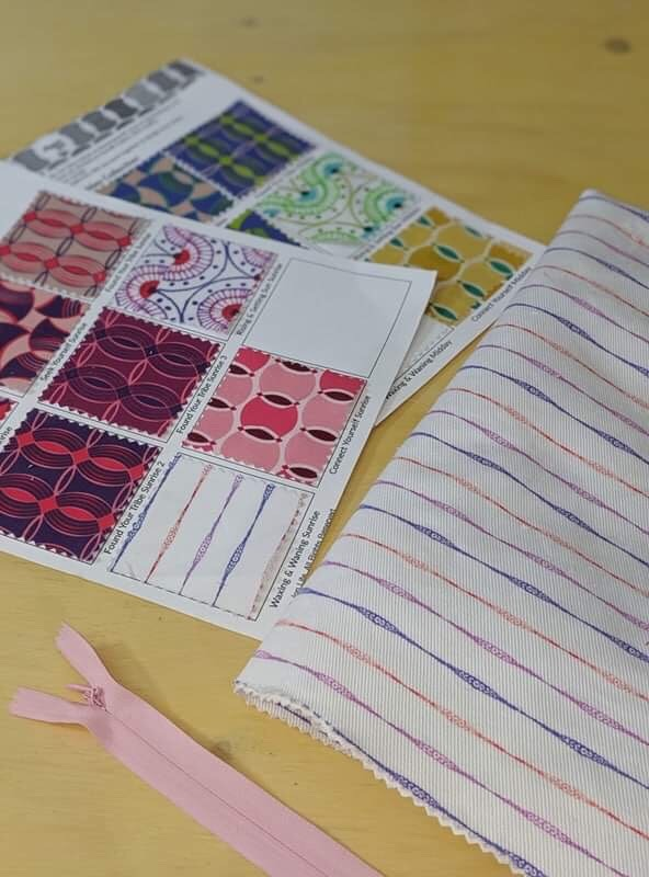 AJL Swatch Cards next to Waxing and Waning fabric