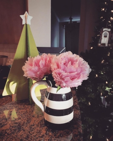 A fun and unexpected combo: spring blooms and Christmas decorations
