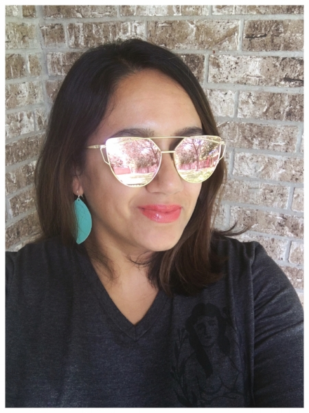 Tinted dry shampoo, mirrored sunglasses, and lightweight leather earrings in full effect!
