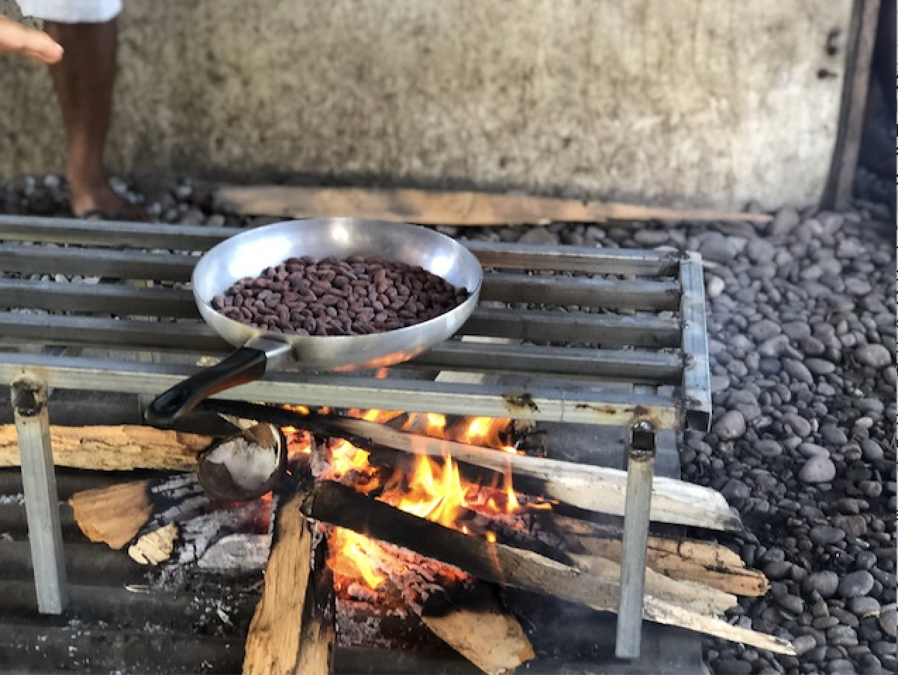 Beans roasting over an open fire, filling the entire village with the aroma, Guadalcanal Solomon Islands.