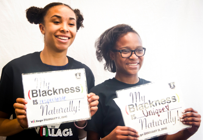 """Two attendees from West High School and Hawthorne Academy represent their """"Black"""" expression at Medicine U (2016)."""