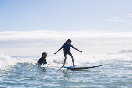 A special Moment captured here. Surfing the wave unsassisted, perfect style and a smile from ear to ear