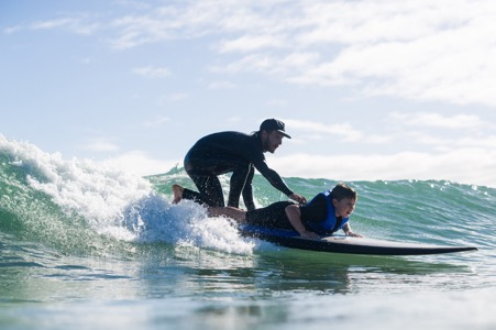 Dropping down the face of the wave in tandem
