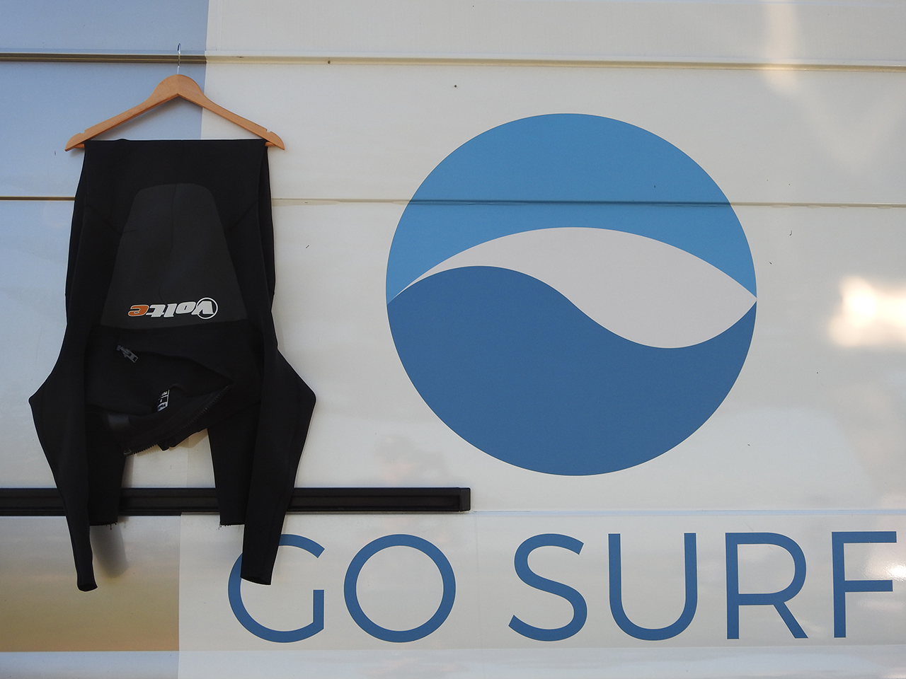 Hang the wetsuit half way!
