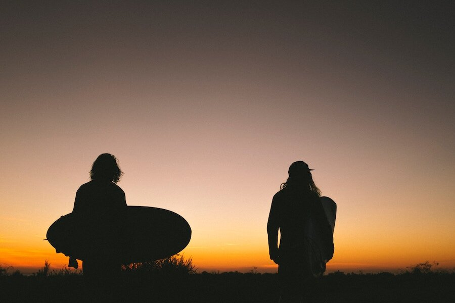 Two friends going for an early morning surf.jpg