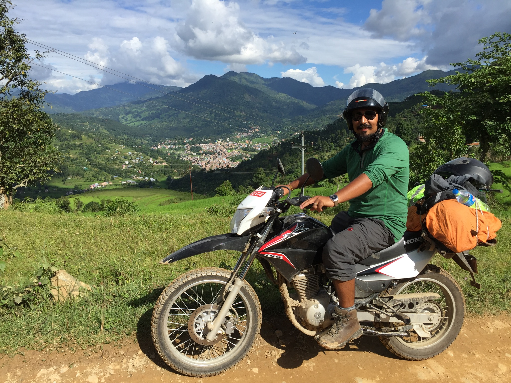 You can see Dhading village here in the distance.  The motorbike will travel through rivers and other terrain for up to 2 miles.