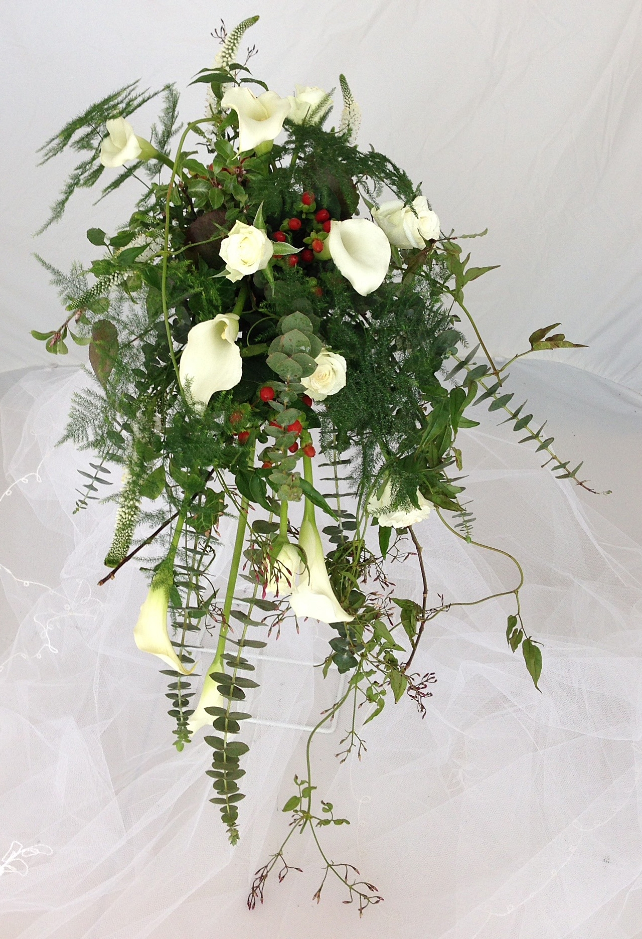 Cascading bridal bouquet in a foam holder