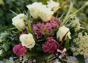 Sedum, dried hydrangea, roses and seed pods