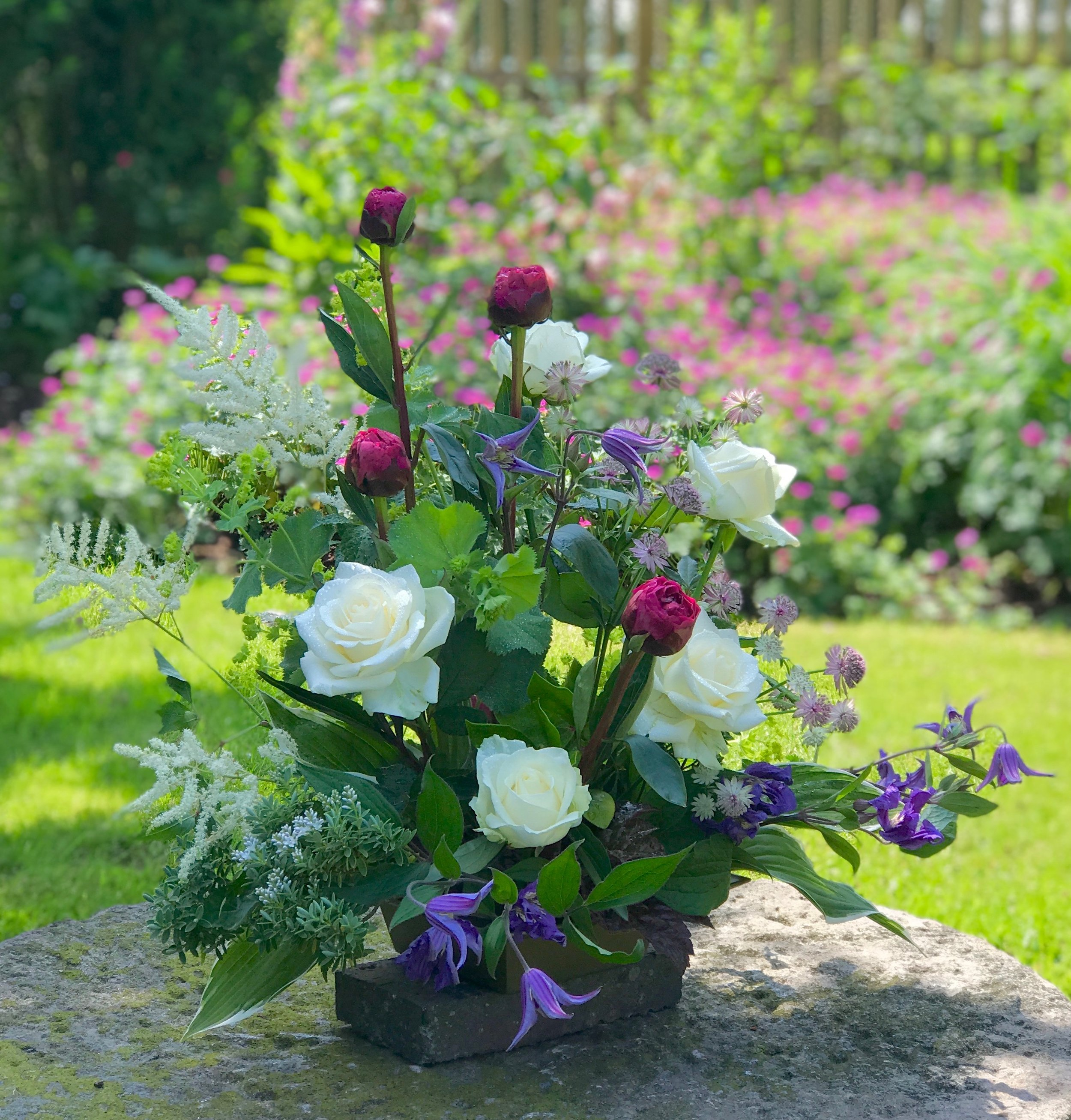 Garden styled Summer arrangement.  (Colours and materials may vary, depends on availability)