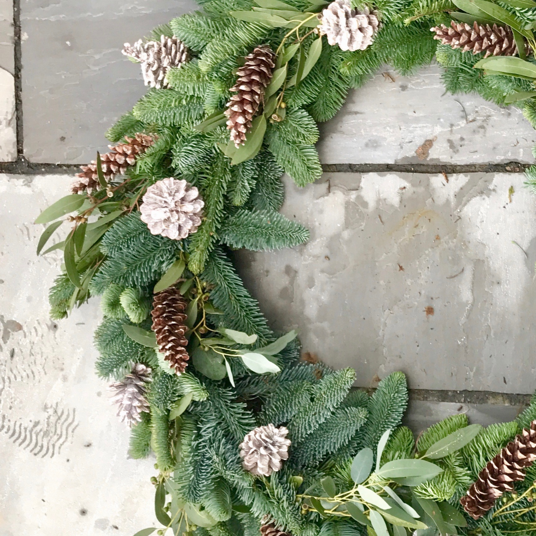 Door wreath using foliages for the garden