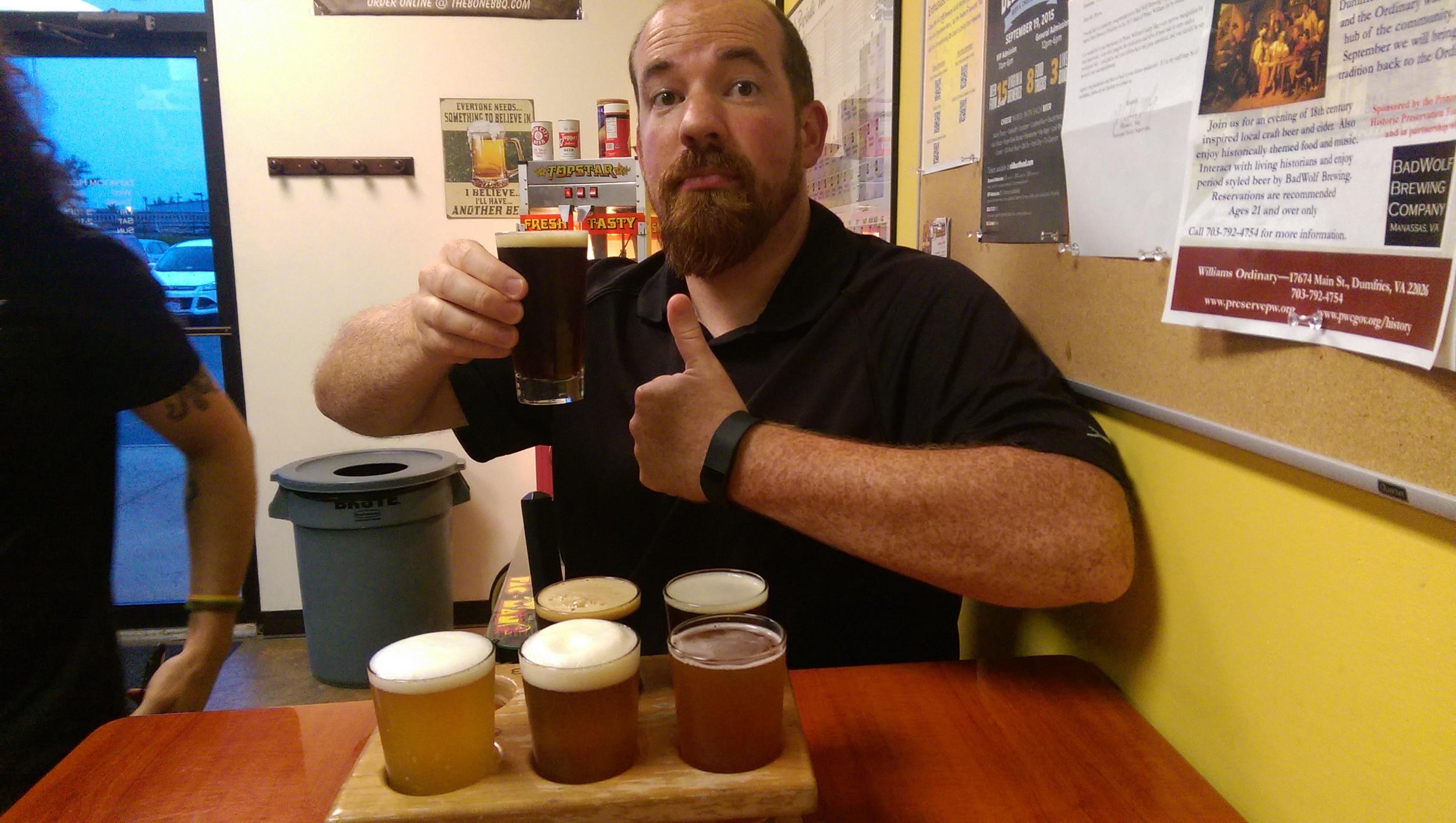 Wesley enjoys a brown ale