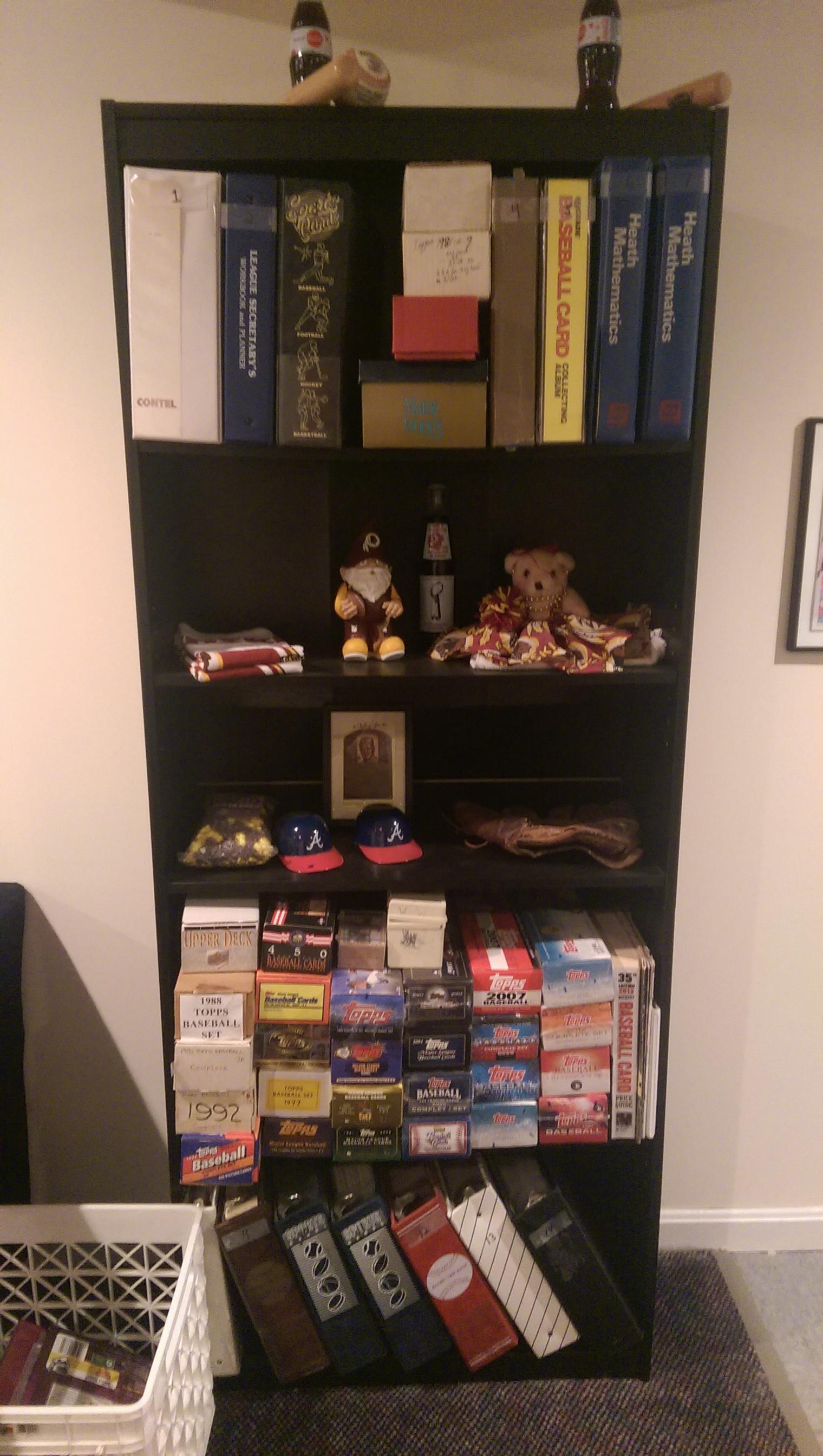 Baseball card shelf. Rizzo slid some of her Redskins stuff onto a shelf.
