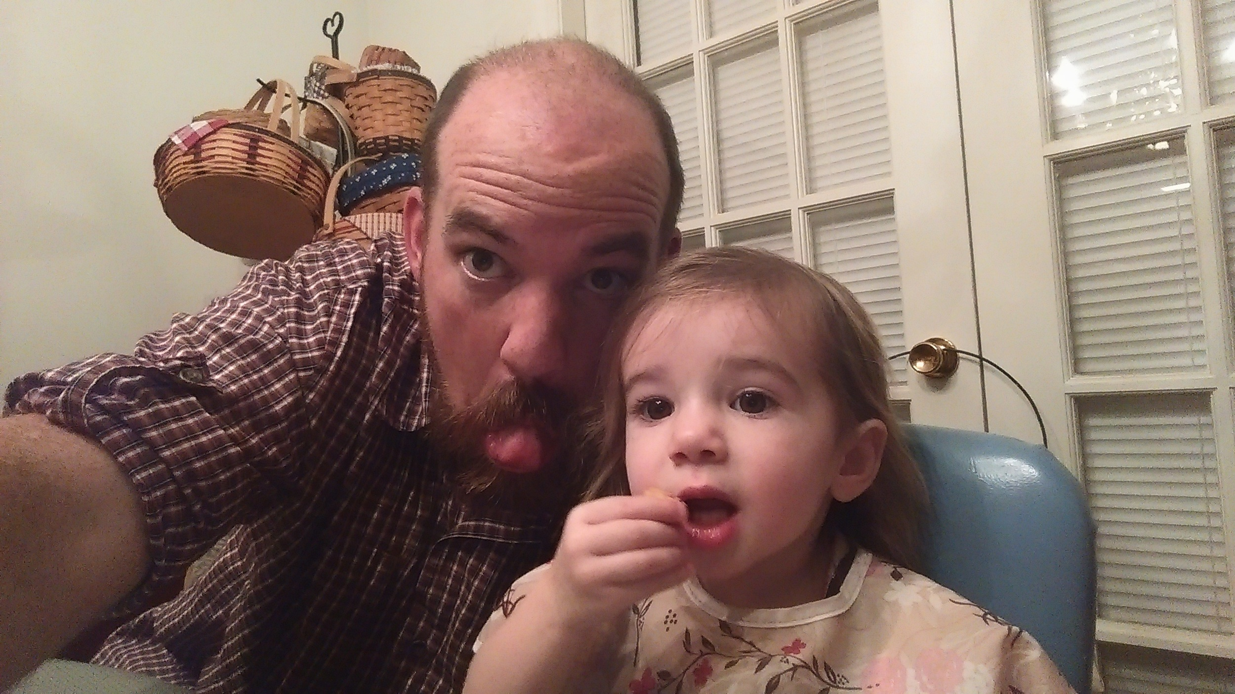 Daddy and Cece goofing off at dinner