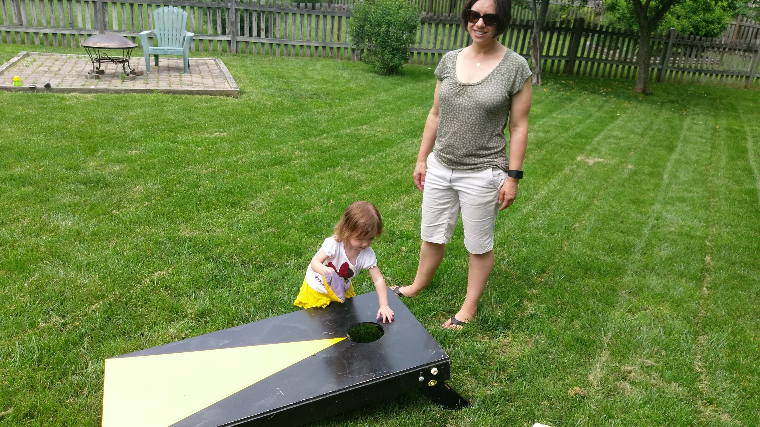 It was such a nice day that Cece decided she wanted to play some cornhole.