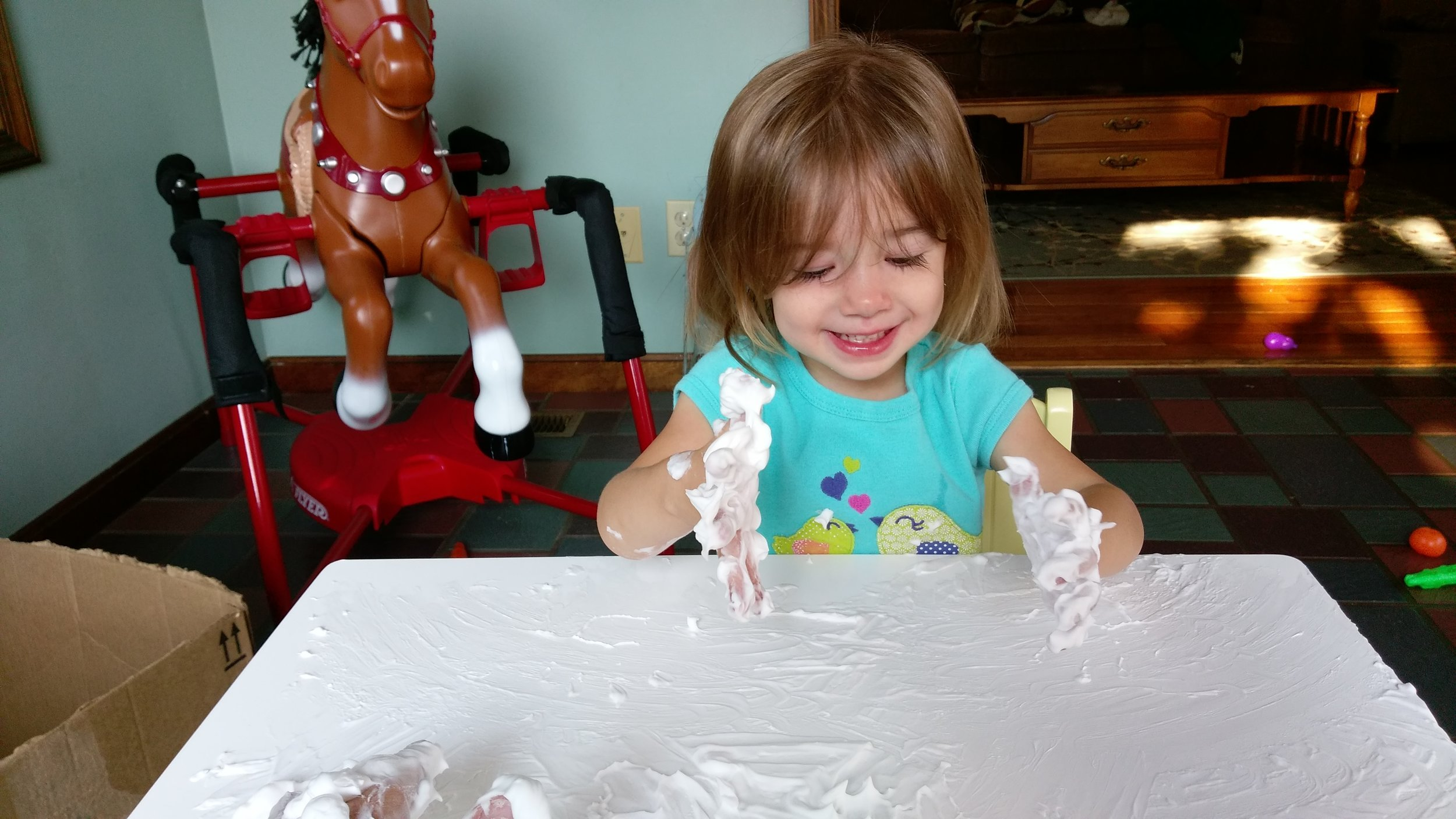 Wednesday morning, pink eye shmink eye, Cece feels great and plays with shaving cream