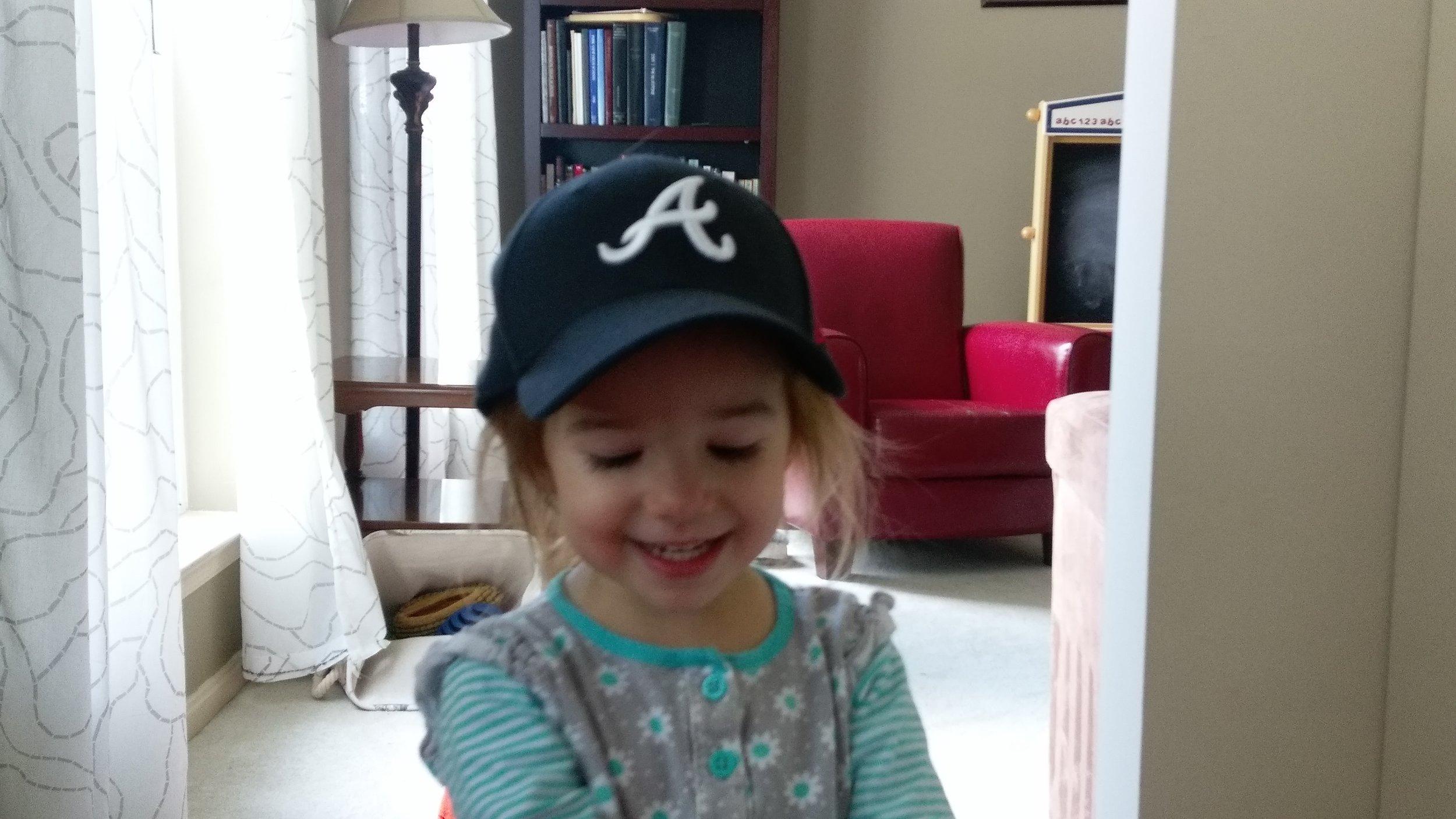 Finally grew into her best hat.