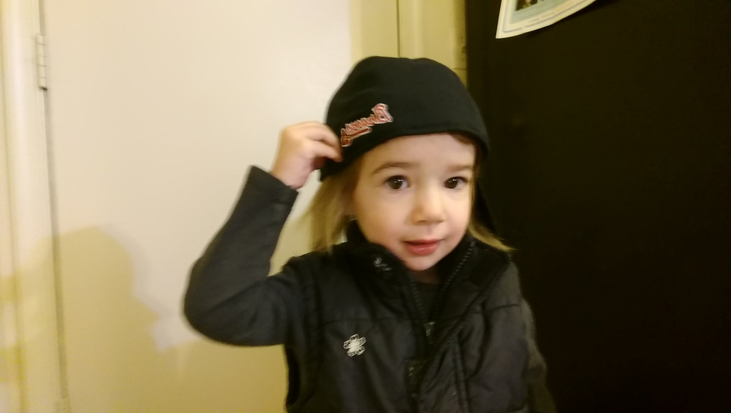 Cool kid in a baseball hat