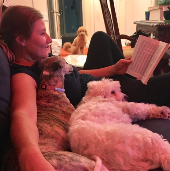 basia reading to doggies.png
