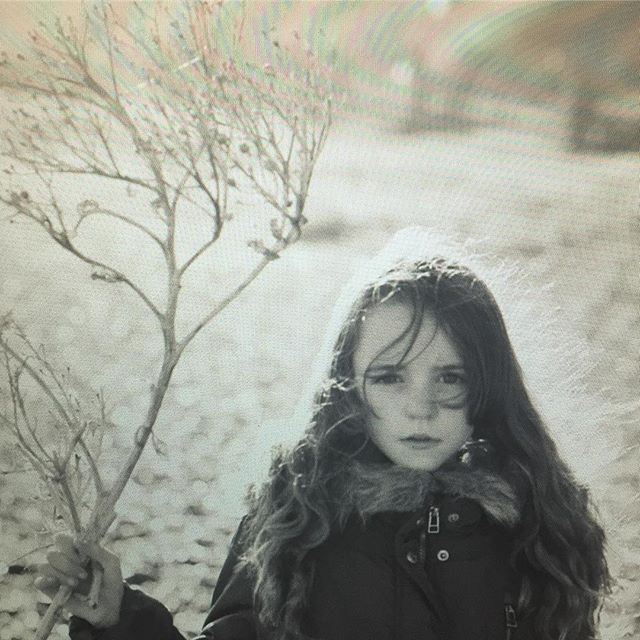 Screengrab : my little one holding a stick she found on the beach #daughter #beach #love #cinematic #winter #winterlight #suffolk #driftwood #sea #canon