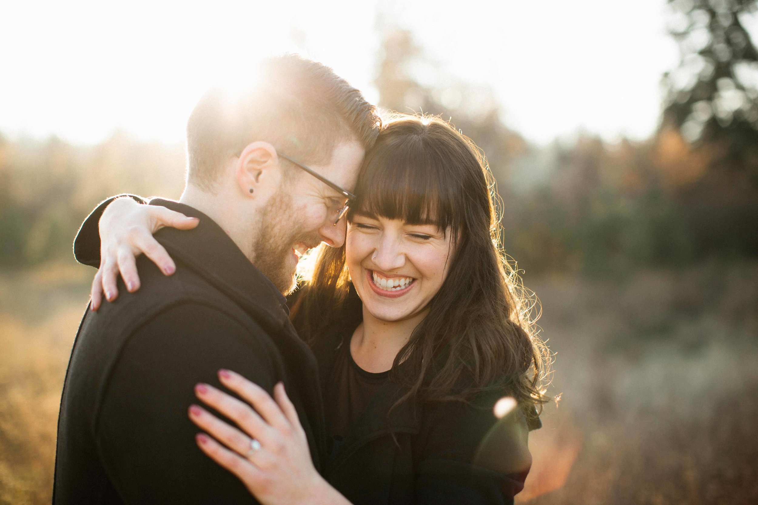 """""""She is truly talented at capturing those authentic moments of laughter and love. - My boyfriend and I had so much fun doing a couples shoot around Riverfront Park in Spokane! Sarah is great at making people feel comfortable in front of the camera and knew how to help us pose. All of her photos are so vibrant and beautiful and you can tell that she absolutely loves photography!"""