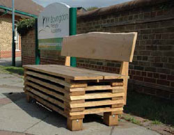The oak bench is just outside the Bovingdon village library and the Primary School.