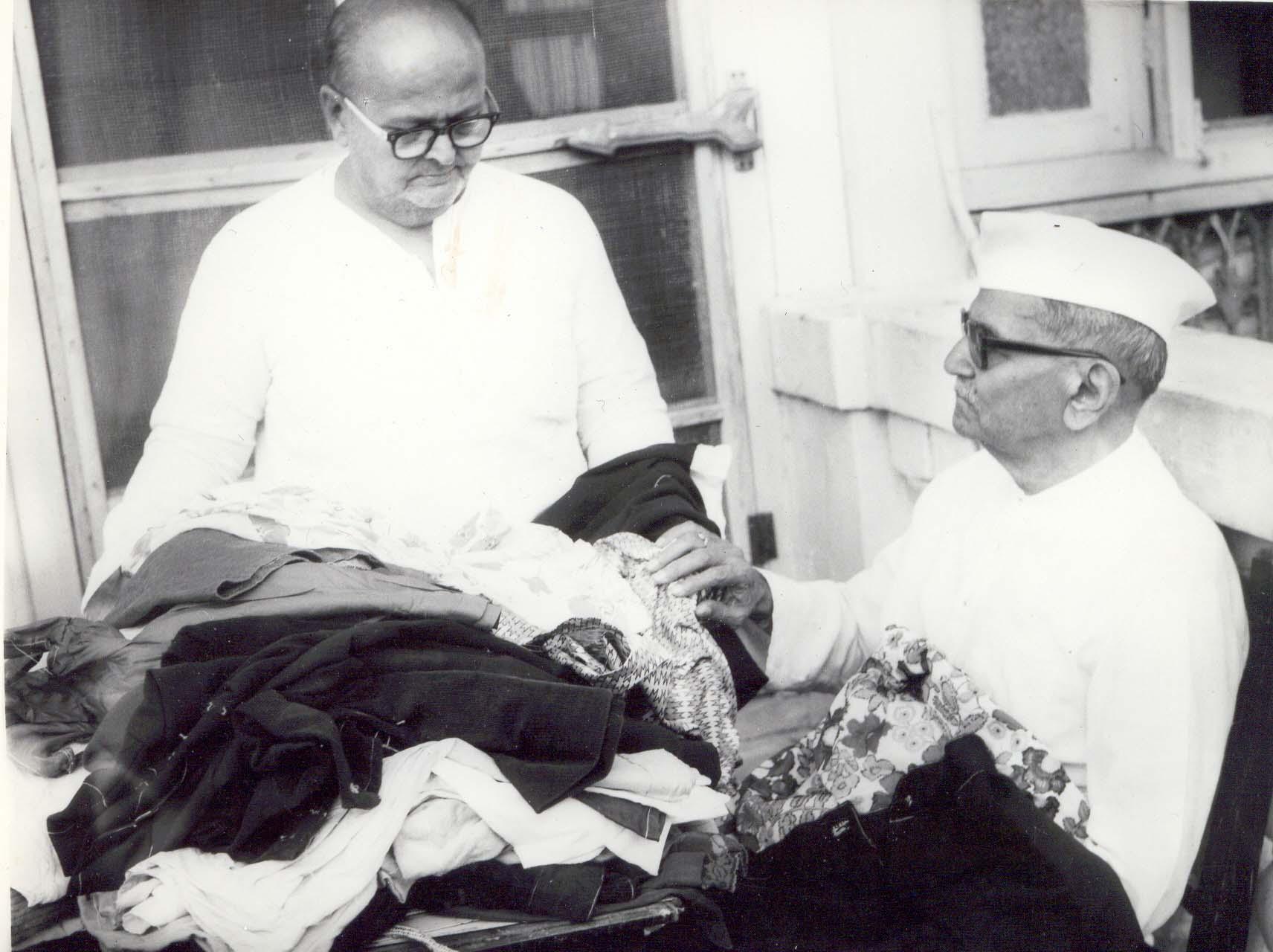 Bapuji distributing clothes.jpg