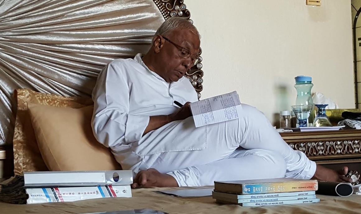 Bhaishree writing his diary.jpg