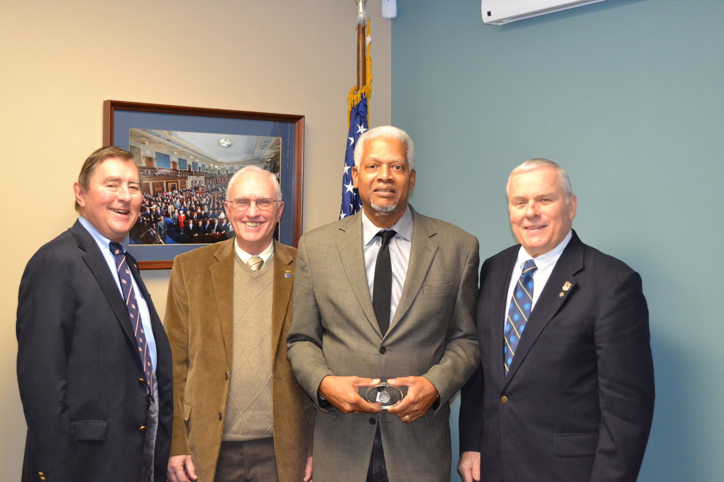 "Representives of the NLUS Atlanta Council meet with Congressman Hank Johnson (GA Dist. 4) to brief him on ""Protecting Sea Lanes. Enabling America's Commerce, and Preserving Commerce and Preserving Peace: The U. S. Navy. Depicted, ( L-R) Atlanta past President Harley Jones, VP Youth Programs Dale Mastley, Contressman Hank Johnson, and VP for Legislative Affairs don giles."