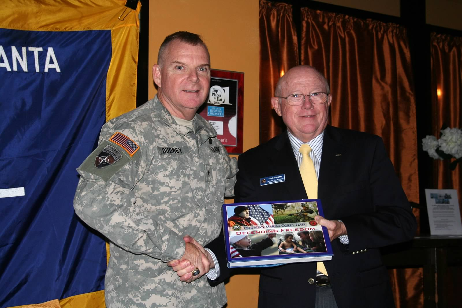 brigadier general lawrence e. dudney, jr. commander of combined joint task force phoenix (Cjtf) fhoenix ix spoke about the role the georgia national guard was playing in afghanistan. council president Frank campbell presented a thank you gift.