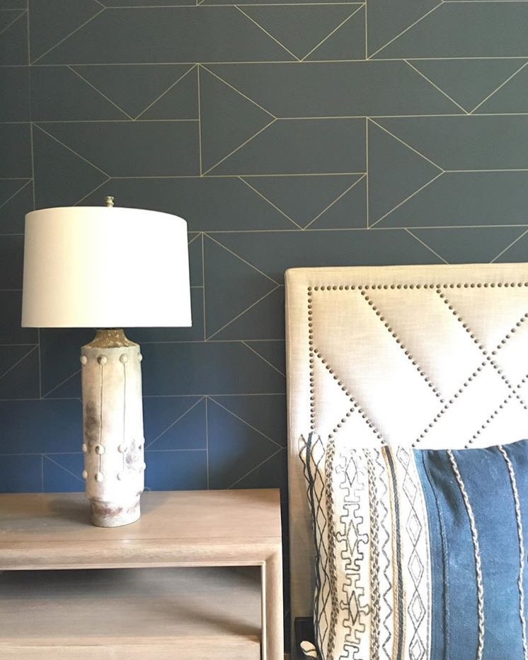 We have seen a trend in metallic shining through simple patterns and textures. This gold geometric outline creates dimension complimented by other geometric patterns in the space.