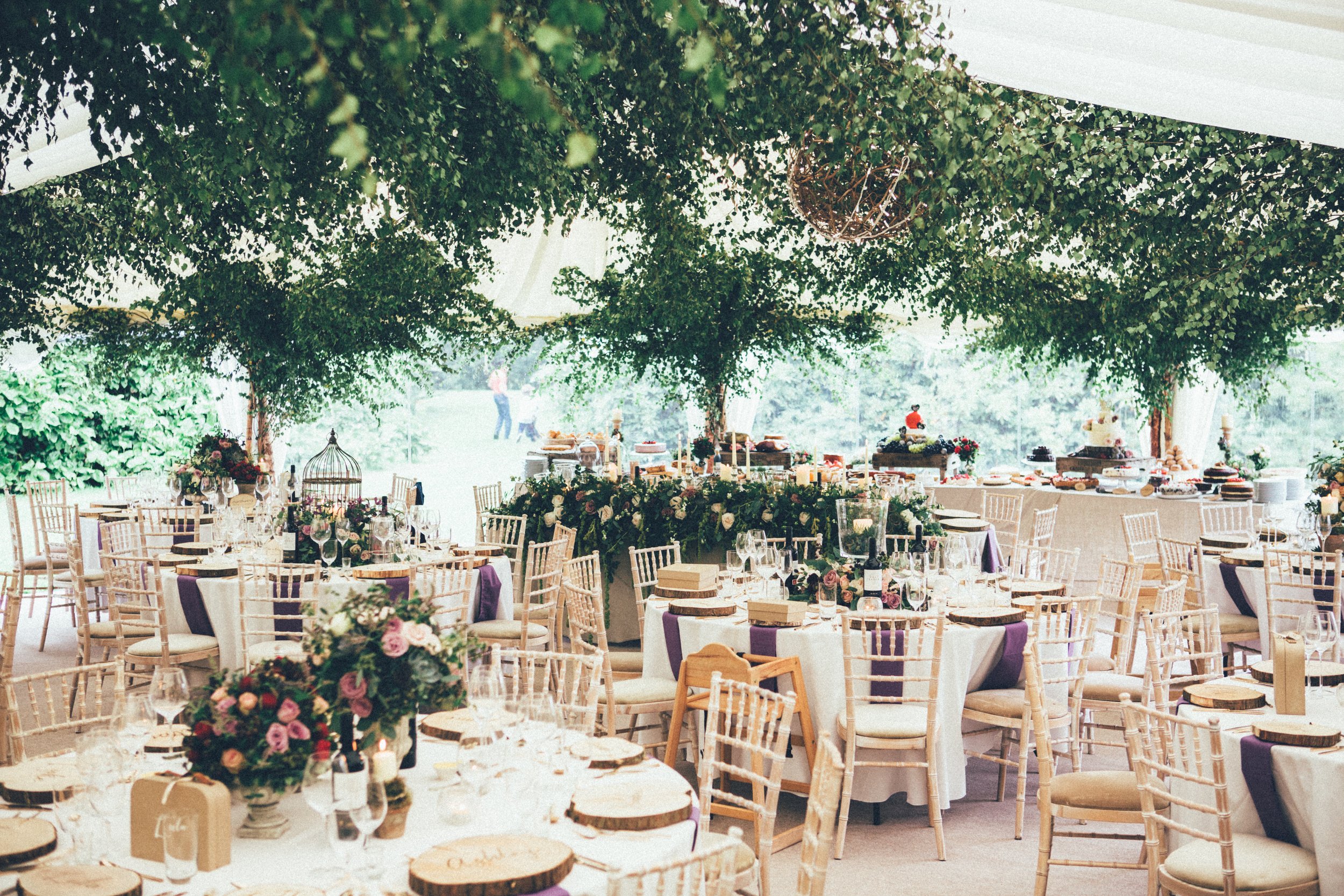 For the ceiling I wanted a lot of tree canopy bringing the outdoors indoors,Claire created this by layering birch foliage from the centre of the ceiling outwards creating trees at the edges of the marquee.