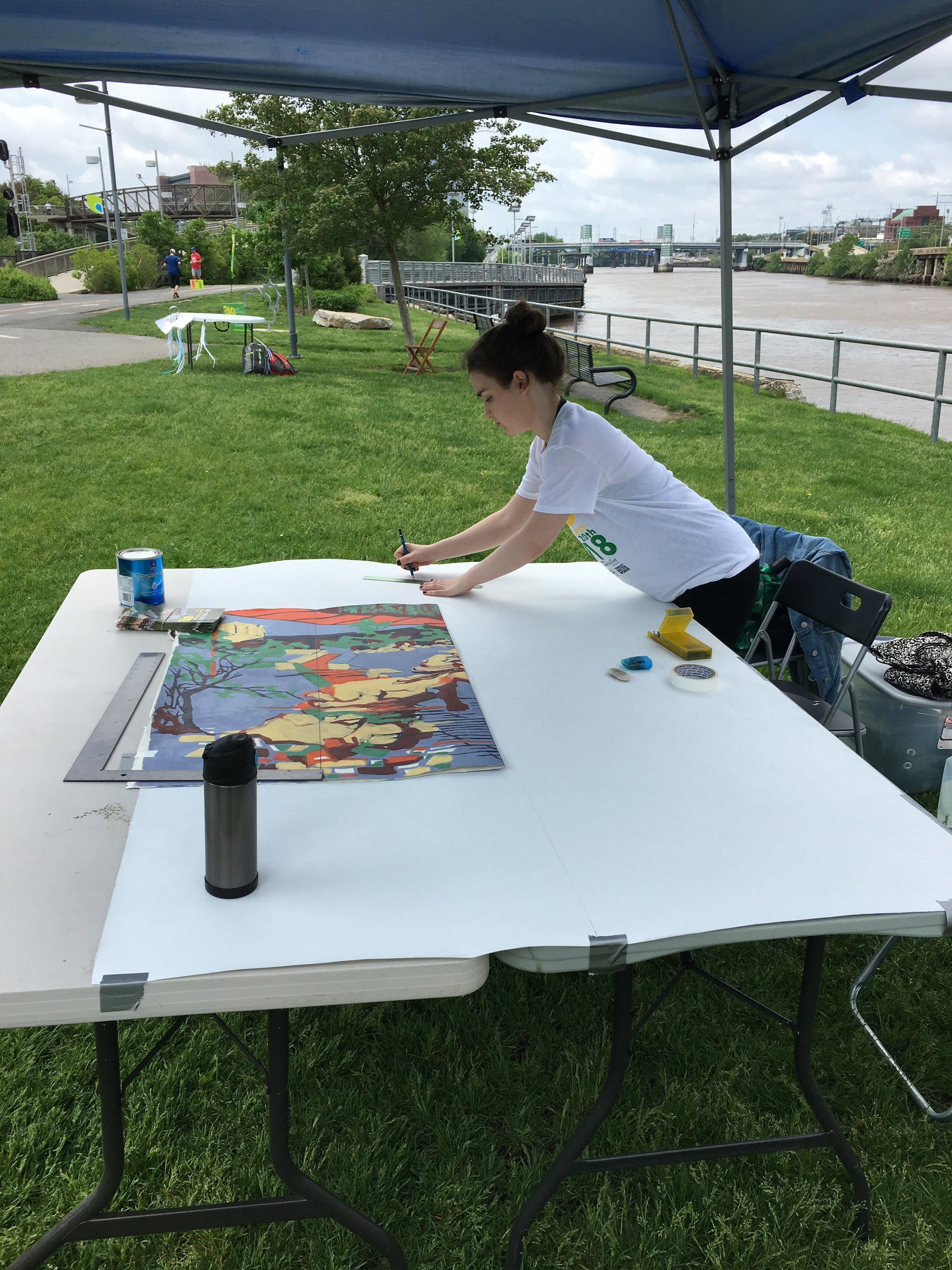Laying out the mural, with Alyssa Willgruber