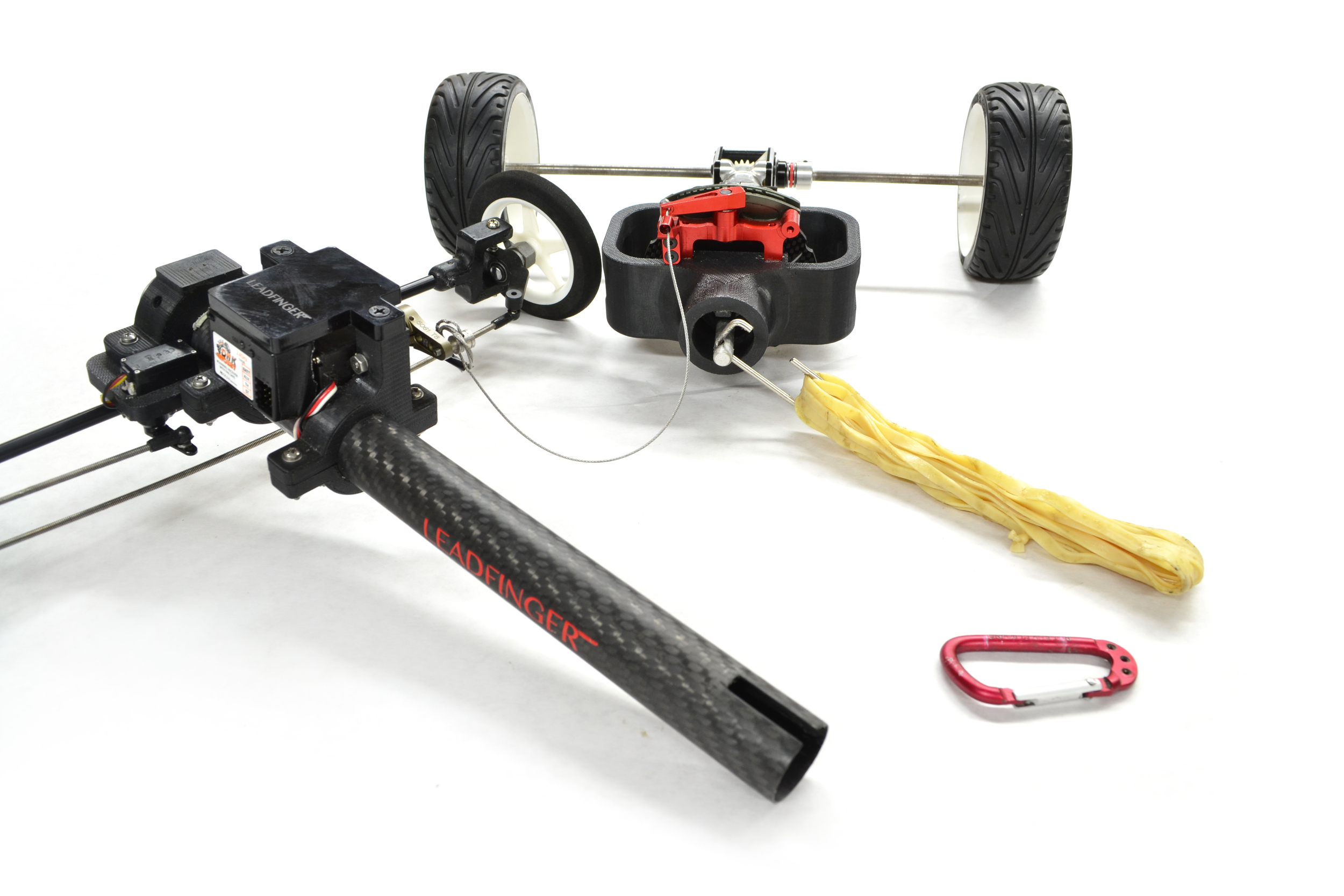 Rubber bands are loaded into the power tube by disconnected the driveshaft portion from the body of the car. Components are keyed and register automatically without additional fasteners.