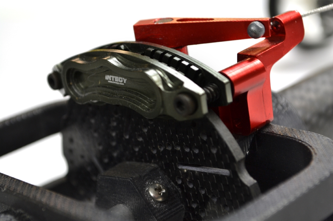"""A """"slipper clutch"""" was made from a large format RC car disc braking system. The clutch allowed rubber band power to be feathered in degrees, not just on and off, adding to control and power conservation."""