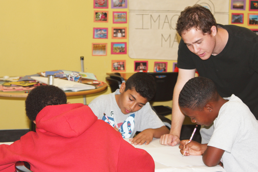 Zach Buchman guides students in a drawing exercise.