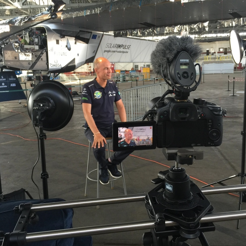 Interviewing a pilot of a solar-powered airplane that circumnavigated the Earth